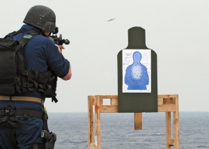"""From Wikipedia: """"PACIFIC OCEAN (Feb. 4, 2008) A member of the visit, board, search and seizure (VBSS) security force aboard the amphibious dock landing ship USS Harpers Ferry (LSD 49) fires his weapon on the firing range during a target practice drill. The VBSS team is training on various weapons and boarding procedures to enhance their proficiency skills when boarding and searching vessels. U.S. Navy photo by Mass Communication Specialist 2nd Class Joshua J. Wahl (Released)"""""""